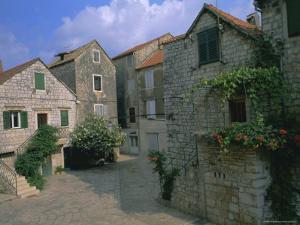 Street in the Port of Stari Grad, Hvar Island, Dalmatia, Dalmatian Coast, Adriatic, Croatia, Europe by J P De Manne