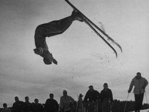 Acrobatic Skier Jack Reddish in Somersault at Sun Valley Ski Resort by J^ R^ Eyerman