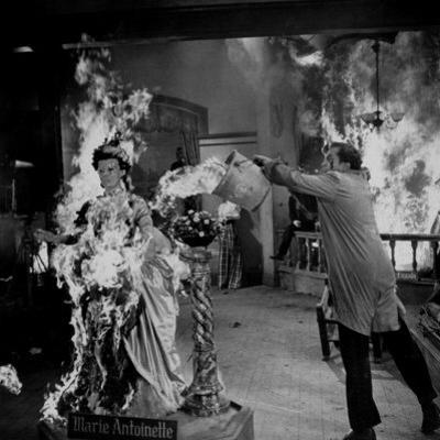 "Actor Vincent Price Putting Out Fire in Film ""House of Wax"""