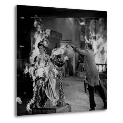 """Actor Vincent Price Putting Out Fire in Film """"House of Wax"""""""