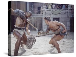 "Actor Woody Strode Squaring Off Against Actor Kirk Douglas in Gladiator Battle in ""Spartacus"" by J. R. Eyerman"