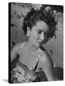 Actress Elizabeth Taylor on the Beach by J. R. Eyerman