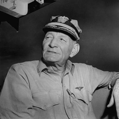 Admiral John S. Mccain, Sitting Aboard a Us Navy Carrier