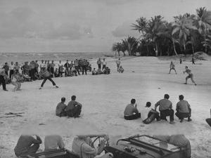 American Servicemen Playing Softball on an Idle Stretch of Runway While Other Soldiers Look On by J. R. Eyerman