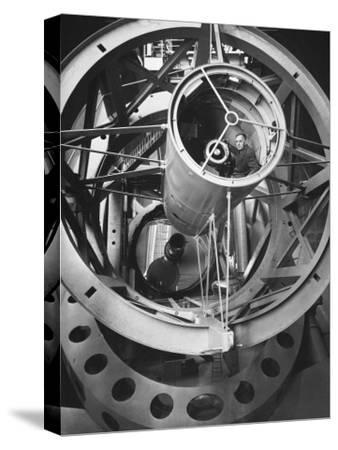 Astronomer Edwin Hubble Pictured Inside the Workings of the Huge 200 In. Mt. Palomar Telescope