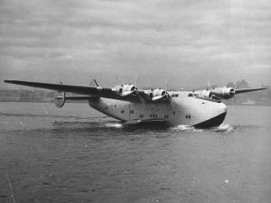 Boeing Clipper Moving on Top of a Body of Water by J. R. Eyerman