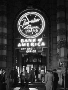 Customers Standing in Front of a Branch of Bank of America, Open from 10 to 10, Six Days a Week by J. R. Eyerman