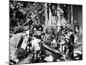 Director Alfred Hitchcock, Bending over to Watch a Rehearsal Through the Camera by J. R. Eyerman
