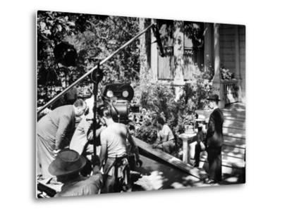 Director Alfred Hitchcock, Bending over to Watch a Rehearsal Through the Camera