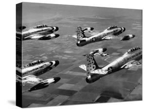 F84 Planes Flying in Formation by J. R. Eyerman