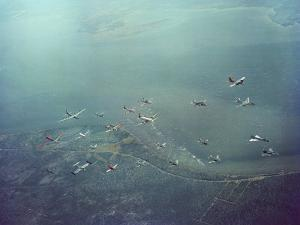 Fleet of US Air Force Operational Planes Flying in a Single Formation over Gulf Coast by J. R. Eyerman