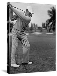 Golfer Ben Hogan, Keeping His Shoulders Level at Top of Swing by J. R. Eyerman