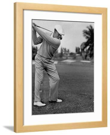 Golfer Ben Hogan, Keeping His Shoulders Level at Top of Swing