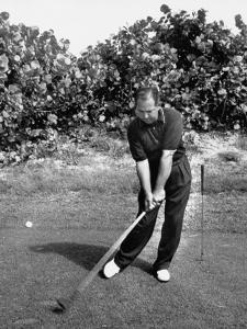 Golfer Claude Harmon Leading with Left Hip as He Hits Ball by J. R. Eyerman