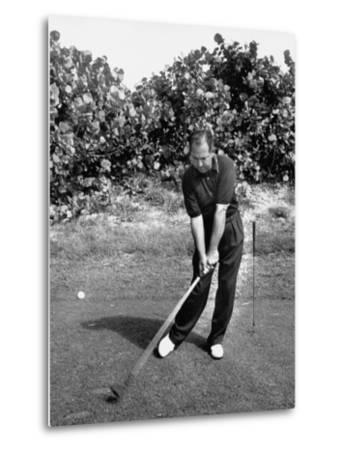 Golfer Claude Harmon Leading with Left Hip as He Hits Ball