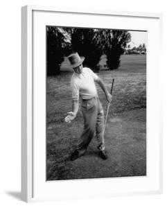 Golfer Sam Snead Demonstrating Sweep of Right Hand in Ben Hogan's Golf Stroke by J. R. Eyerman