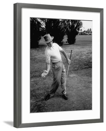 Golfer Sam Snead Demonstrating Sweep of Right Hand in Ben Hogan's Golf Stroke