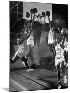 Harlem Globetrotters Playing in a Basketball Game by J. R. Eyerman