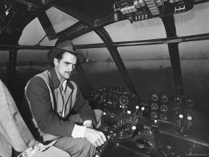 """Howard Hughes Sitting at the Controls of His 200 Ton Flying Boat Called the """"Spruce Goose"""" by J. R. Eyerman"""