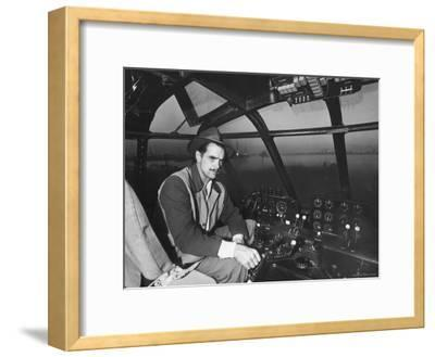 "Howard Hughes Sitting at the Controls of His 200 Ton Flying Boat Called the ""Spruce Goose"""