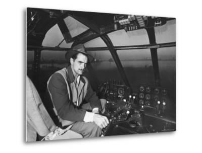 """Howard Hughes Sitting at the Controls of His 200 Ton Flying Boat Called the """"Spruce Goose"""""""