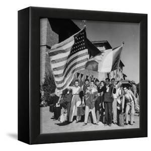 Mexican Farm Workers Waving American and Mexican Flags by J. R. Eyerman