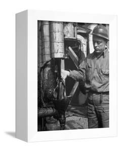 Miner Working at Oil Shale Refinery Mine by J. R. Eyerman