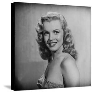 Movie Starlet Marilyn Monroe Posing in Studio by J. R. Eyerman