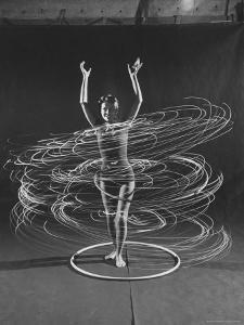 Multiple Exposure of a Woman Playing with a Hula Hoop by J. R. Eyerman