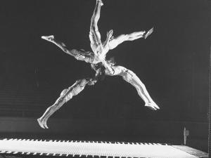 Multiple Exposure Shot of a Gymnast Jumping on a Trampoline by J. R. Eyerman