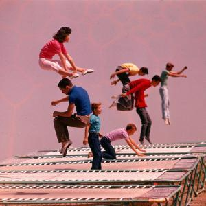 People Bouncing on Trampolines at Trampoline Center by J. R. Eyerman