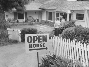 Realtor Pat Devault Showing a House to Her Clients by J. R. Eyerman