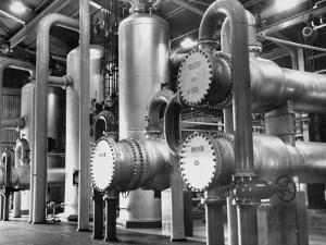 The Inside of a Gas Conservation Plant Showing Massive Pipelines by J. R. Eyerman