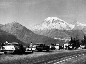 Tourist Looking at Mt Rainier in Southwest Washington by J. R. Eyerman