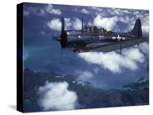 US Navy SBD Dauntless in Flight During Palau Islands Air Raid Attack by J. R. Eyerman