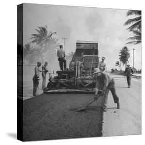 US Navy Seabees Spreading Asphalt During Creation of Air Base by J. R. Eyerman