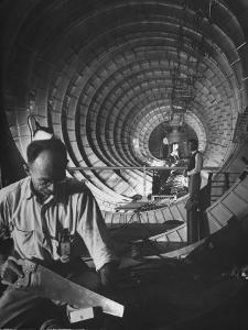 Workmen Building Flying Boat That Was Designed by Millionaire Howard R. Hughes by J. R. Eyerman