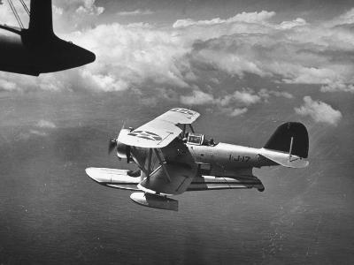 J2F Utility Plane Flying over Pacific Ocean-Peter Stackpole-Photographic Print