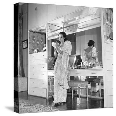 1949: Consuelo Madrigal Putting Make Up on for a Party