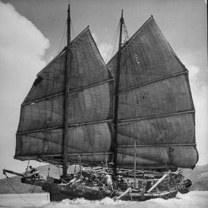 Junk Leaving Harbor with Patchwork Sails Up by Jack Birns