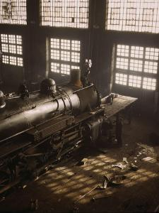 Working on a locomotive at the 40th Street railroad shops, Chicago, 1942 by Jack Delano