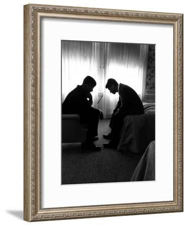 Jack Kennedy Conferring with His Brother and Campaign Organizer Bobby Kennedy in Hotel Suite-Hank Walker-Framed Premium Photographic Print