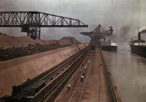 Ships Approach a Vast Dock to Unload Millions of Tons of Iron Ore by Jacob Gayer