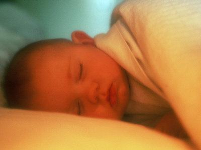 Baby Lying in Bed Sleeping