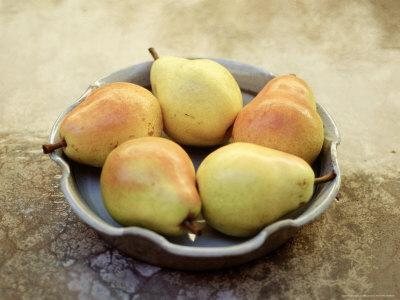 Still Life of Pears on an Olive Background