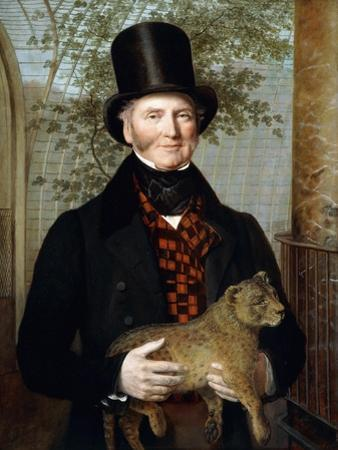 Portrait of Edward Cross, Half-Length, in a Black Coat and Red-Check Waistcoat Holding a Lion Cub