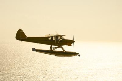 A PA18 Super Cub Floatplane Flying to Conception Island by Jad Davenport
