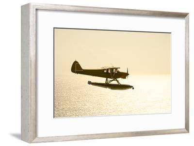 A PA18 Super Cub Floatplane Flying to Conception Island