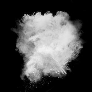 Freeze Motion Of White Dust Explosion Isolated On Black Background by Jag_cz