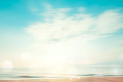 A Seascape Abstract Beach Background. Panning Motion Blur and Bokeh Light of Lens Flare, Pastel Col